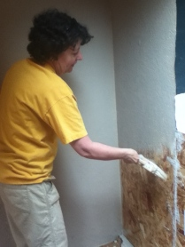 Laurie from the Visioning Team joins in the painting